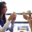 Happy women licking ice cream — Stock Photo #7743161