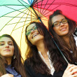 Smiling girlfriends under umbrella — Stock Photo #7743846
