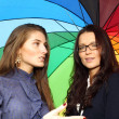 Stock Photo: Girlfriends under umbrella