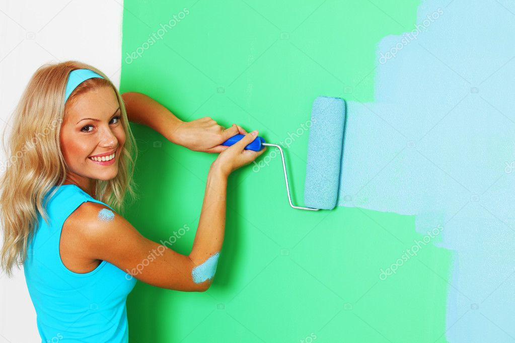 Woman paints the wall roller  Stock Photo #7860295