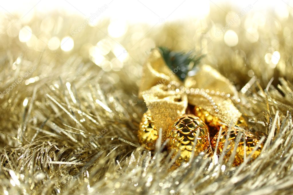 Golden christmas ball on christmas background — Stock Photo #7860546
