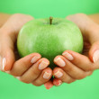 Apple in woman hands — Stockfoto