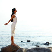 Meditation on sand beach — Stock Photo