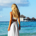 Woman on tropical beach — Stock Photo #7941767