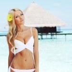 Woman on tropical beach — Stock Photo #7941783