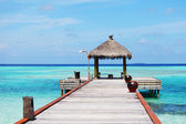 Resort maldivian houses in blue sea — Stock Photo
