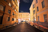 Night view from the court into the lighted street.JPG — Stock Photo