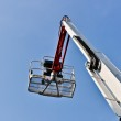 White hydraulic construction cradle against the blue sky — Stock Photo