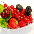 Berries in a plastic box on a white background — Stock Photo