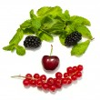 Funny face from different berries on a white background — Stock Photo