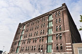 Low angle view to the old brick factory building — Stock Photo
