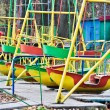 Swing boats in the old amusement park — Stock Photo