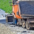 Laying asphalt. asphalt paver machine and worker. - Stock Photo