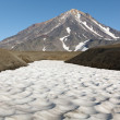 Snowfields and Koryaksky  volcano in Kamchatka — Stock Photo