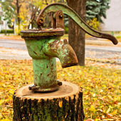 Rusty olf water pump — Stock Photo
