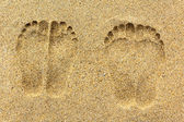 Foot prints on the sand — Stock Photo