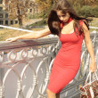Beauty drunk woman in red dress in the city — Foto Stock