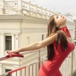 Beauty woman in red dress in the city — Foto Stock