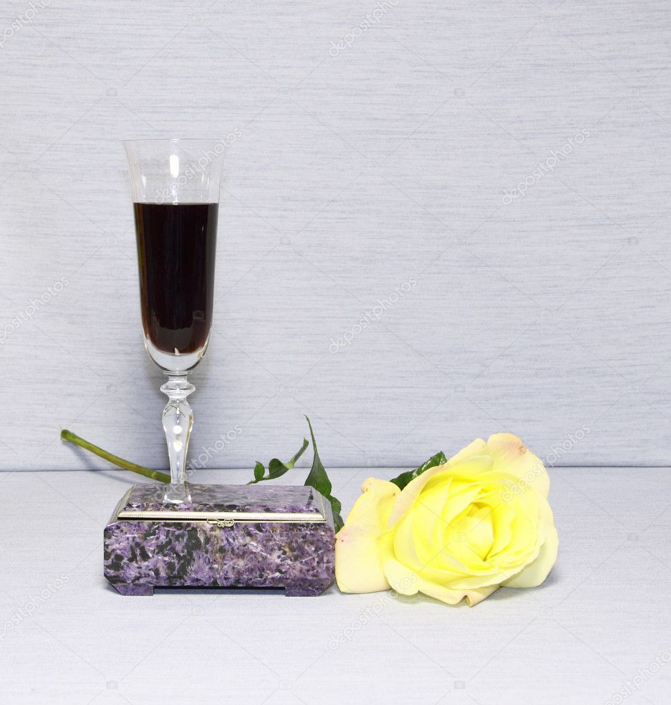 A glass with wine, a casket and a yellow rose   Stock Photo #7238815