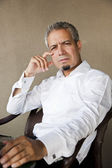 Portrait of a handsome indian businessman with grey hair — Stock Photo