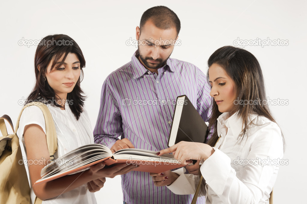 Group of a multi ethnic students studying together — Stock Photo #7461032
