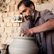 Potter making a terracotta vase - Stock Photo