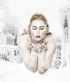 Snowqueen is blowing snowflakes — Stock Photo