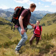 Couple hiking in mountains — Stock Photo #6864649