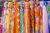 Multicolor shawls and scarves. — Stock Photo