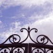 Stock Photo: Sky view through gates.