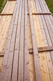 Long wooden planks loaded in a bunch. — Stock Photo