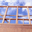 Newly constructed wooden frame house fragment. — Stock Photo #7399161
