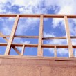 Stock Photo: Newly constructed wooden frame house fragment.