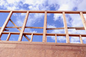 Newly constructed wooden frame house fragment. — Stock Photo