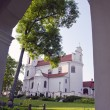 Stock Photo: Religous Calvary church looking through arch.