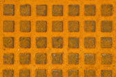 Great rusty iron metal sewer lid background. — Stock Photo