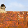 Rusty roof tin and ramshackle brick chimney. — Stock Photo #7908165