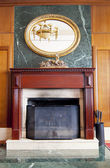 Modern fireplace in wooden and marble interior — Foto Stock