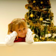 Girl by Christmas Tree — Stock Photo #7403817