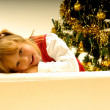 Stock Photo: Girl by Christmas Tree
