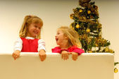 Kids by Christmas Tree — Stock Photo