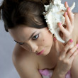 Beautiful girl in spa treatments listening shell — Stock Photo #7043381