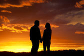 Romantic couple at sunset. — Stock Photo