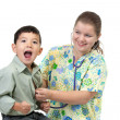 Boy reacts to cold stethoscope. — Foto Stock