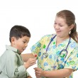 Nurse gives boy candy. — Stock Photo