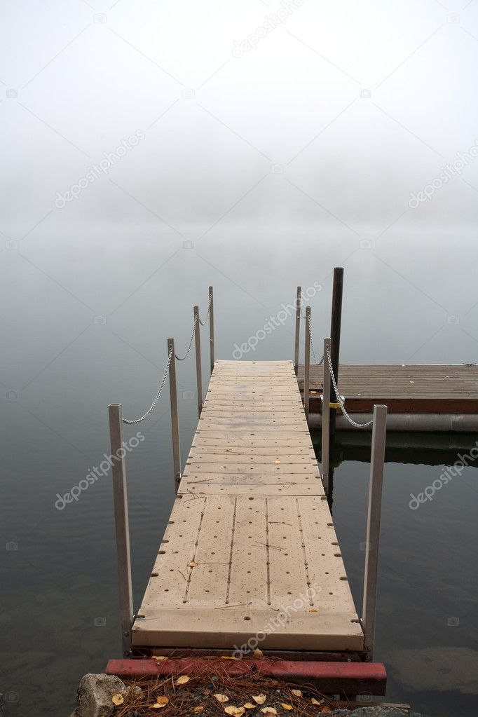 An image of a serene scene of a ramp leading to the dock.  Stock Photo #7431013
