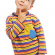 Smiling little boy thinking about — Stock Photo