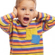 Little boy closing ears with his hands — Stock Photo
