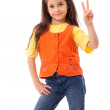 Smiling little girl with victory sign — Stock Photo #7320333