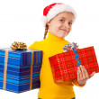 Smiling girl in Santa hat with two gift boxes — Stock Photo #7510197